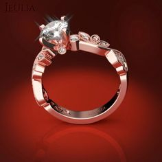 360 view of Leaf-shaped Design Rose Gold White Sapphire engagement ring