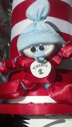 Close up of Thing 2 baby corsage by Bumble Bee creations (socks & mittens wrapped with Satin ribbon-gorgeous!)