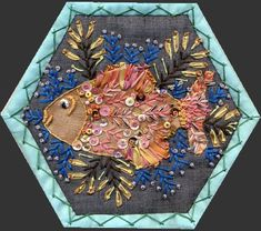 This is just one block of a hexagon/embroidery quilt! Can't imagine the time spent on this.Gipsy Quilt: BeeQuilt