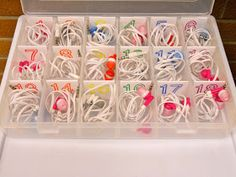 Have the kids bring in their own ear buds for computer and listening station.  Store them in a bead box!