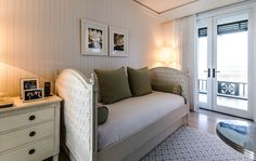 Kid Chic   A sunny kids room features bead board walls and French-style daybed dressed with plush pillows.