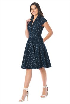 75fa54cc6e9 A notched portrait collar and pleating at the inset high waist style our  sail boat print