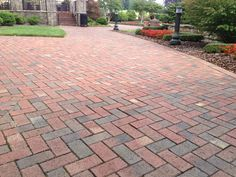 This long brick driveway is made with Pine Hall Brick Old Towne pavers.