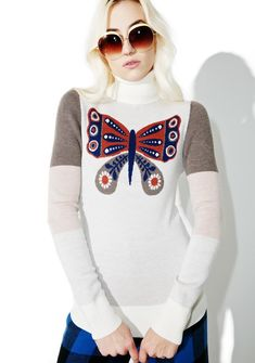 Sugarhigh + Lovestoned Mariposa Turtleneck evolve into yer true form, babe. Stay cozy in this warm turtleneck that features a merino wool construction, banded hem and sleeves, and yer cute af butterfly friend on the front.