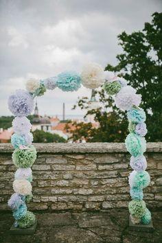 paper pom wedding ceremony arch / http://www.himisspuff.com/pom-poms-decor-ideas-for-your-wedding/2/