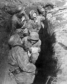 German Waffen SS lying low in a trench. Hungary, March, 1945.