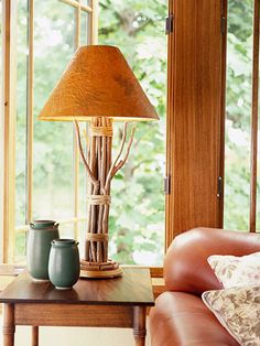 DIY Twig Lamp Keep this look natural by leaving the twigs as is; add a contemporary flair by spray-painting the twigs before you make the lamp. Twine Crafts, Glue Crafts, Button Lampshade, Natural Lamps, Do It Yourself Furniture, Eclectic Living Room, Better Homes And Gardens, Lampshades, Diy Lampshade