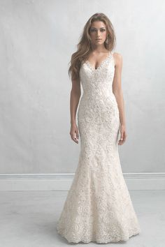 Modern, romantic, and nothing short of incredible! This v-neck sheath wedding dress features gorgeous beaded lace all over. Madison James by @allurebridals