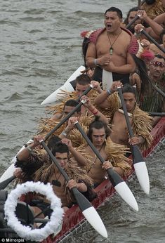 New Zealand Maori. Look at the guy in the front, he is making a face a the camera!