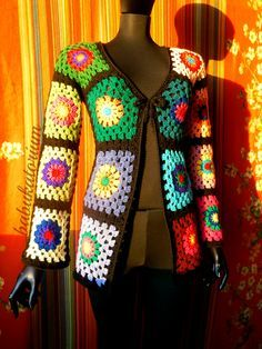 "https://flic.kr/p/dFkkZa | Granny Square Sweater - The Ultimate Circles To Squares Design In 32 Colors Of The Rainbow | This psychedelic granny ""circles to squares"" cardigan is made of 32 differently colored blocks, all bordered with black. I used vintage, recycled and new yarns for this project. Closed with a replaceable long black, furry crochet cord decorated with circle motifs and colorful buttons (red-green and blue-orange)."