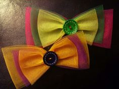 A pair of hair bows. One royal, the other Easter themed. http://www.facebook.com/littledragonbabyboutique