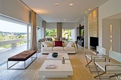 Italian travertine lines the living room and the terrace of a Marcos Bertoldi-designed house in Brazil