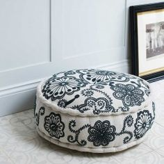 Kashmir Linen Pouffe: This gorgeous Kashmir Embroidered Linen Pouf in grey on ecru linen is perfect for use as a footstool or low seat.  An eyecatching addition to any room!