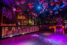 At Lola Lo Derby there is a flock of 52 mirror ball carrying parrots over the dance floor. - design and specialist fit-out - nightclub - tiki - 2014 - eclectic bars and clubs - derby -