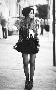 Skater skirt, band tee, leather jacket. Perfect grunge street style look!
