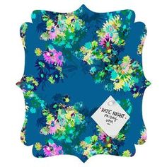 Floral-print magnet board with a quatrefoil silhouette by Bel Lefosse Design.
