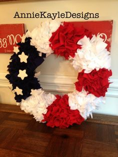 14 Inch Flag wreath with springy white stars.  Perfect to hang on your door all year! I can add your name for an extra price. Email me if you would like to do that and I can send you a different pay pal. anniekayledesigns@gmail.com
