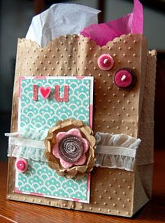 embossed paper bag decorated to use as a Valentine gift bag.  Love it!