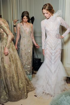 Backstage at Valentino Couture. I love their hair!