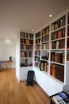 Bespoke corner library unit in South East London