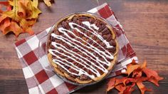 Recipe with video instructions: With a cinnamon roll crust, this pecan pie is packed with sweet, nutty goodness. Ingredients: For the crust, 1 pie crust, store-bought or homemade, ¼ cup unsalted butter, room temperature, ½ cup brown sugar, 2 tsp cinnamon, For the filling, ¾ cup light corn syrup, ¼ cup dark corn syrup, 1 cup of brown sugar, ¾ tsp salt, 1 ½ cups pecan pieces, toasted, 3 eggs, 2 tsp vanilla extract, 1 cup pecan halves