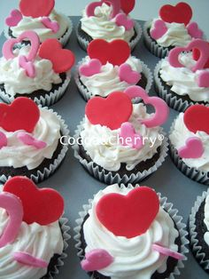 Valentine's cupcakes, fondant topper and buttercream frosting.