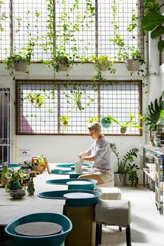 The Ceramic House, a studio, store, workshop and cafe with walls of greenery. Ceramic Cafe, Ceramic Store, Ceramic Studio, Eco Store, Greenery Decor, Purple Door, Best Boutique Hotels, Ceramic Houses, Atelier