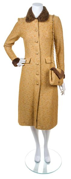 An Adolfo Tweed Wool Ensemble, comprised of a coat with a fur collar and cuffs, decorative front button closure and two faux pockets, together with a pleated A-line skirt with an elastic waistband and a matching handbag with a goldtone chain strap and fur trim.