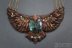 Garuda necklace by Mandarin Duck. I used labradorite, turquoise and aventurine stones to decorate this necklace along with gold plated elements and swarovski crystals. It is approx 15cm wide and 10 cm tall. www.mandarin-duck.com