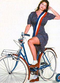 Laetitia Casta rides a bike. With training wheels.
