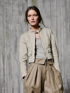 Burda 128 Desert Moto jacket - leave off the waist pockets and add one on the arm. Maybe do a long vertical flap pocket on one of the seams on the front.