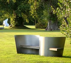 S Seat designed by architect Ian Ritchie CBE in timber and stainless steel shot-peened with glass bead