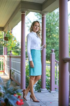 white button down shirt with turquoise lace skirt
