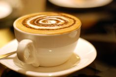 Taking a sip of the perfect cup of coffee.