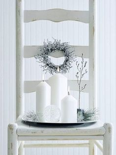 We love the look of these wintery entryway decorations. More Christmas candle decorations: http://www.bhg.com/christmas/indoor-decorating/christmas-candle-displays/?socsrc=bhgpin110712glowinggreeting#page=10