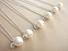 Love these!   Bridesmaid Gift - 6 Cream or White Pearl Hand Stamped INITIAL Necklaces in Sterling Silver - choose pearl color  - 10% off. $124.20, via Etsy.