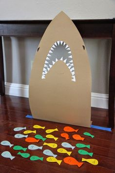 Toddler Approved!: Feed the Shark Alphabet Game for Kids  Read: Clark the Shark Dares to Share by Bruce Hale...activities certainly can be adapted to classroom needs during a shark theme in your classroom...Have fun with it. Feed the shark with reading, math, writing activities...Imagination is all that is required... #Toddlerphonics