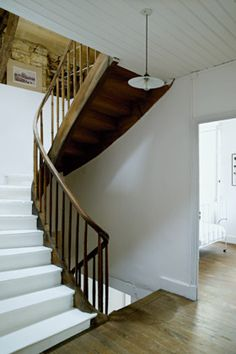 White wooden staircase with wooden railings - Rustic French Country Home Interior Design in Paris Timber Staircase, Staircase Handrail, Wooden Staircases, Stairways, Wood Railing, Spiral Staircases, Stair Railing, Rustic French Country, French Country House