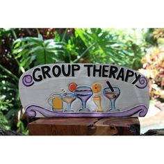 """This Tiki Bar sign is a hand made wooden """"GROUP THERAPY"""" sign with a refreshing cocktail! This great piece of hand craft measures 12 inches long by 10 inches tall. Very Tropical and tiki bar decor. Pe"""