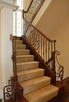 wood and rod iron staircase | 14. CLOSE UP OF WROUGHT IRON AND WOOD STAIR CASE TO 2ND FLOOR.jpg