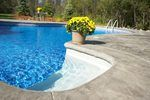 If the surface of your swimming pool is getting a bit rough, stained or discolored, you can resurface it yourself. This weekend project will dramatically improve the overall appearance of your pool and your entire backyard.