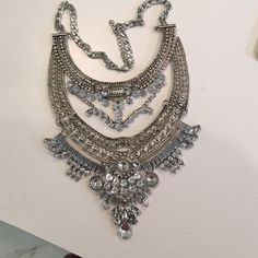 Stunning silver rhinestone statement necklace Vintage look rhinestone waterdrop layered tassel necklace. Dress-up any outfit. Perfect for the bride or anyone else who likes to look fabulous.  Super sparkly. Drop dead gorgeous Jewelry Necklaces