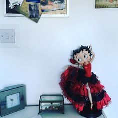 Betty's back!! Anyone know how to clean these fabrics without ruining them? It doesn't detach! Just hoping my mini lion  doesn't knock her down!  #bettyboop #dancing #redandblack #dollstagram #betty #boop #boopboopbedoop #pretty #seniorita #cute