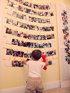 J's First Birthday Photo Display Wall... I think he liked it!!