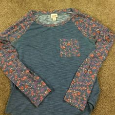 Casual blue shirt with floral sleeves. This shirt is casual and comfy. Has been worn still in good condition with some pilling. Mossimo Supply Co. Tops Tees - Long Sleeve