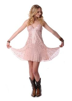 Love Taylor Swift's dresses and boots!