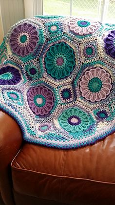 Purple Passion Flower Garden Afghan on Ravelry (Cognac Matelassé Afghan pattern by Priscilla Hewitt).