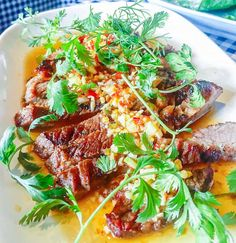 It's charcoal-grilled, tender meat with all those classic bright, tangy Thai flavors: garlic, coriander, soy, sugar, chiles and lime.   http://rootandrevel.com