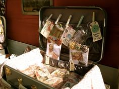 using suitcases for booth displays