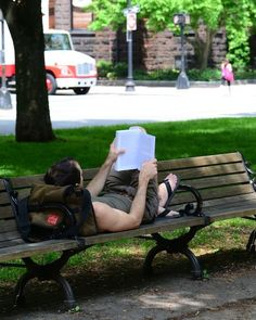 Relaxing on a shady park bench as a convenient place to get in some reading.